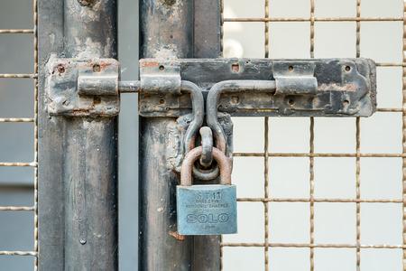 keep gate closed: Rusty Key lock old metal door