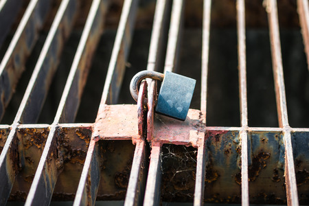 Rusty Key lock wire mesh photo