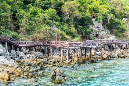 Wooden Bridge on Beautiful seascape and white sandy beach of Koh Lan, Pattaya, Thailand photo