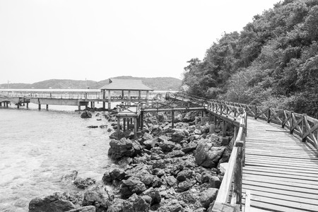Wooden Bridge on Beautiful seascape and white sandy beach of Koh Lan, Pattaya, Thailand photo