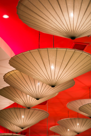 Gold and red japanese umbrella lamp for background photo