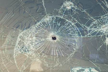 gunshot: Car with bullet holes in the windshield Stock Photo