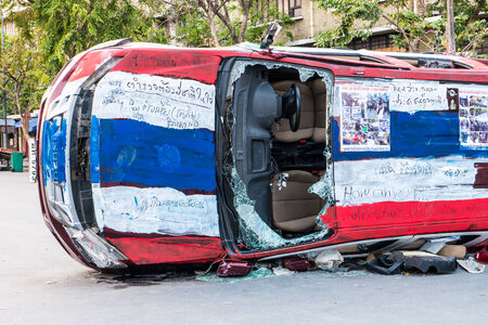 anti fascist: BANGKOK-FEB 22  Police Car damaged and broken, Thai police clash with anti-government protesters at Democracy-monument, Ratchadamnoen Road on February 22, 2014 in Bangkok, Thailand