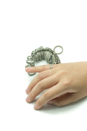 jeweler: hand with Jeweler finger sizing tool