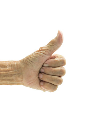 posing  agree: Senior woman hand thumb up isolated on white background