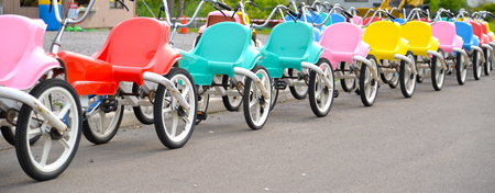 tricycle: A row of children tricycle at playground Hokkaido Japan