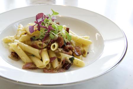 olio: Penne with garlic and oil aglio e olio on white plate