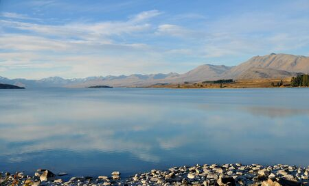 tekapo: Quiet Lake Tekapo, New Zealand. No people Stock Photo