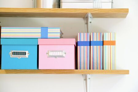 photoalbum: Wooden shelf with boxes and photo album