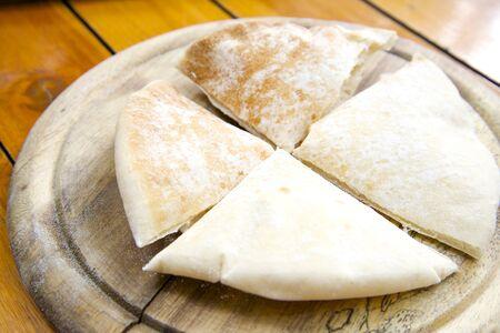 pita bread: Slices of pita bread on wooden stand Stock Photo