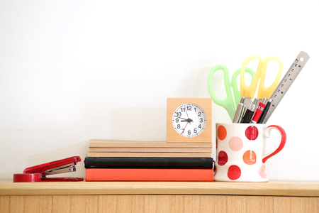 Stationary at home office, white wall background