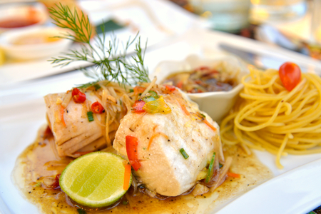 fish plate: Steamed fish with spicy ginger sauce on white plate Stock Photo