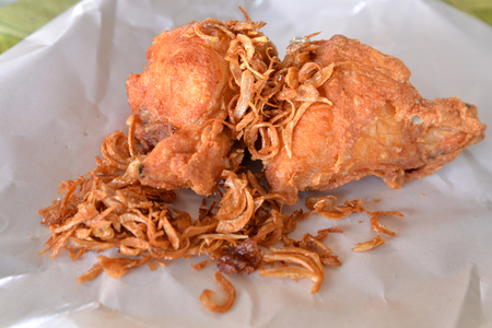 southern: Thai southern style deep fried chicken with fried red onion, wrap in paper, Thailand street food