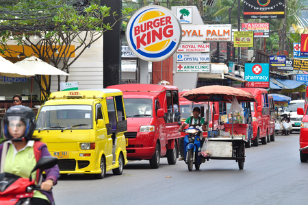 phuket food: Local man is driving his food bike along the busy street of Pathong Beach, Phuket, Thailand. Editorial