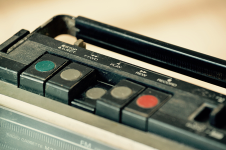 cassette tape: Dusty old radio with one cassette player