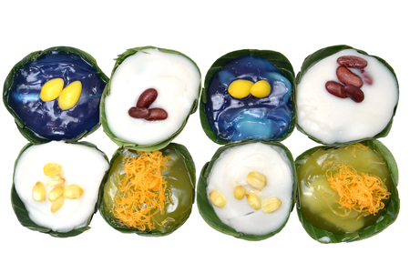 eg: Creative Thai pudding with many topping e.g. coconut milk, butterfly pea, red bean, lotus seed Khanom Tako, Thailand Stock Photo
