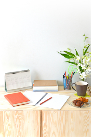 Home office table with stationary and coffee