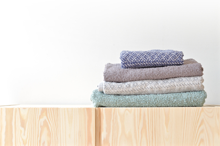 Folded towels on the cupboard at home