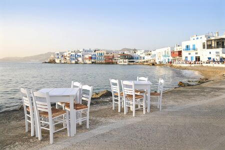 little venice: Many dining table are set along Little Venice waterfront for customers to enjoy sunset at Mykonos, Greece