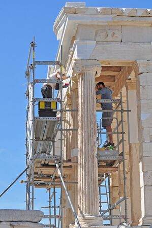 archaeologists: Archaeologists are restoring the detail of the building at Acropolis, Athens, Greece Editorial