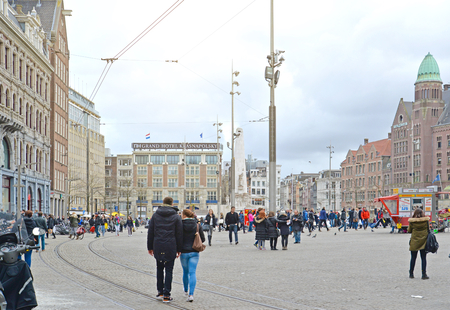 dam square: Tourists and local people visit Dam Square which is a famous town square in Amsterdam, Netherlands.