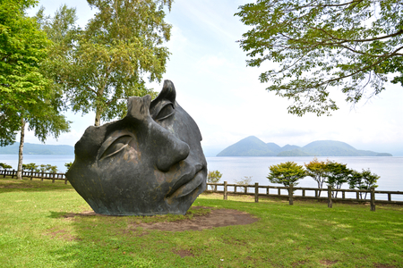 Face sculptures is seen at Toyako Sculpture Park around Toya Lake, Hokkaido, Japan