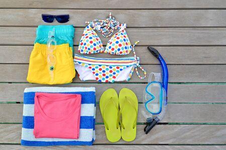 beachwear: Beachwear from top view with sunglasses, goggles, bikini, sandal, short and towel, Maldives Stock Photo