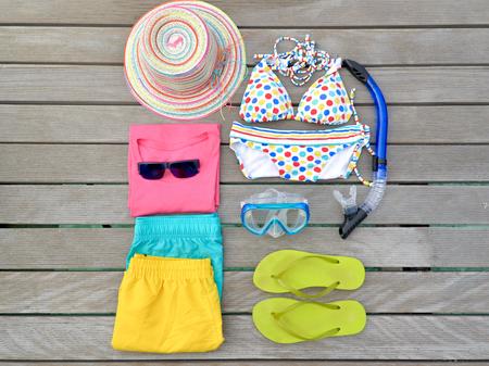 beachwear: Beachwear from top view with sunglasses, bikini, sandal, short and hat, Maldives