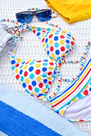 beachwear: Colorful beachwear with sunglasses and towel