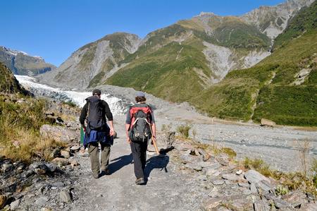 fox glacier: Tourists are trekking at Fox Glacier, New Zealand. Editorial