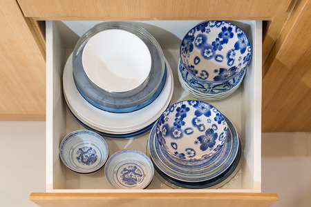 Open drawer with dishware in the kitchen Stockfoto