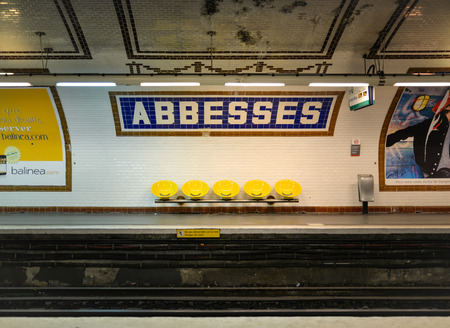 waiting passengers: There is no waiting passengers  at Abbesses station since the train just left. This subway station is the deepest station in Paris, France.