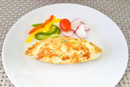 omlet: Egg white omelet with bell pepper, tomato and radish on white plate