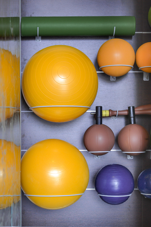 eg: Fitness equipment on storage rack eg. ball, mattress Stock Photo