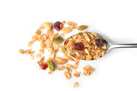 Homemade granola with honey, oatmeal, nuts, raisin and cranberry on white background - isolated