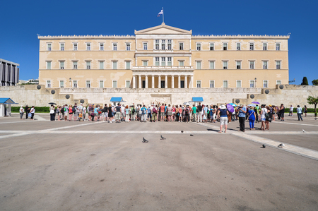 syntagma: Many tourists are gathering to watch the changing of the Guards ceremony in front of House of Parliament, Syntagma square, Athens, Greece