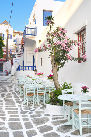quite time: Mykonos, Greece - May 31, 2013: Restaurant along the small alley is quite empty during day time in Mykonos, Greece