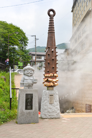 sengen: Demon statue with the club is guarding the entrance of geyser which water flow from Hell valley at Sengen Park, Noboribetsu, Hokkaido, Japan