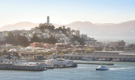 coit tower: Coit Tower is seen from Treasure Islands, San Francisco, USA.