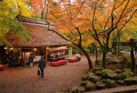Tourists are taking a rest, having some food and tea at traditional style teahouse after a walk in Nara Park, Nara, Japan