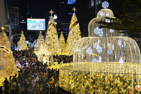 Many people come to taking picture of Christmas and New Year decoration light in front of Central World department store, Bangkok Thailand