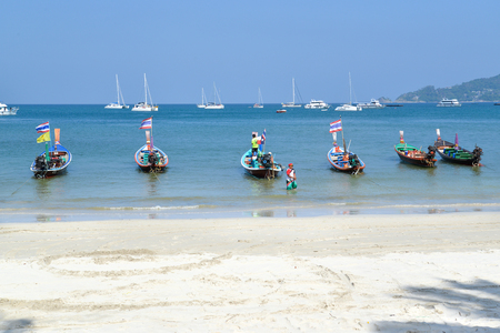 Long tail boat is waiting for tourists for day tour at Patong beach, Phuket, Thailand
