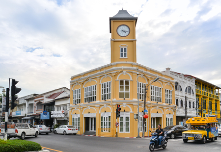Clock tower is seen from across corner of the street in Phuket old town, Phuket, Thailand Editorial
