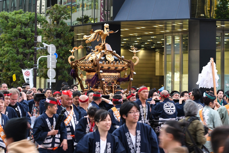 Tokyo, Japan - May 14, 2017: The parades of portable shrines (mikoshi) are passing along the Akihabara area during Kanda Matsuri festival Editorial