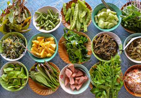 Variety of  local vegetables having with curry rice noodle (Thai Southern style) Stock Photo