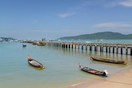 Phuket, Thailand - July 23, 2017: Many local boats and ships are mooring at Chalong Pier, Phuket, Thailand. Editorial