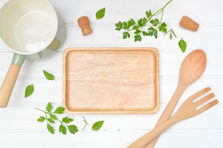 Cooking background with wooden plate from top view