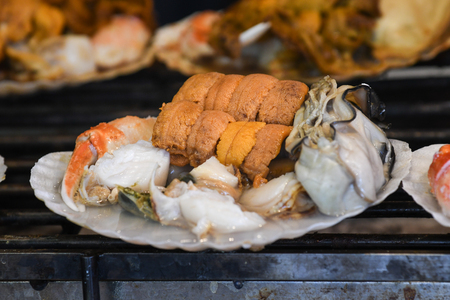 Variety of seafood grilled on scallop shell, Tokyo, Japan