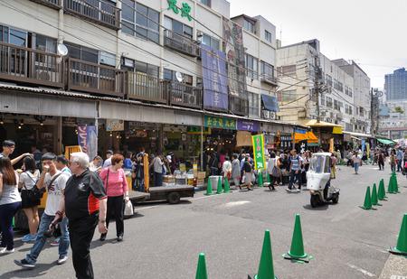Tokyo, Japan - May 16, 2017: Many people are walking and shopping along the street at Tsukiji fish market, one of the largest fish markets, Tokyo, Japan