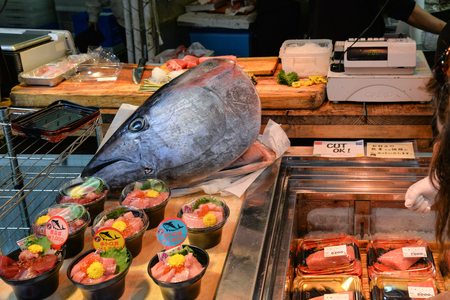Tokyo, Japan - May 16, 2017: Raw cut tuna, Otoro, is sold along the street at Tsukiji fish market, Tokyo, Japan